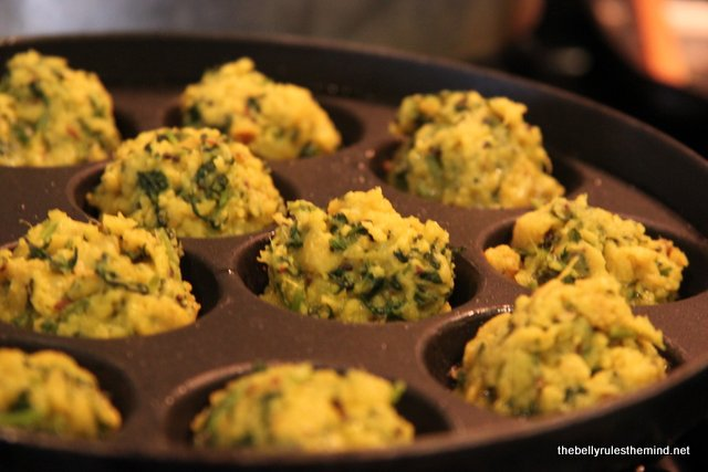 Cilantro Fritters cooking in appe pan