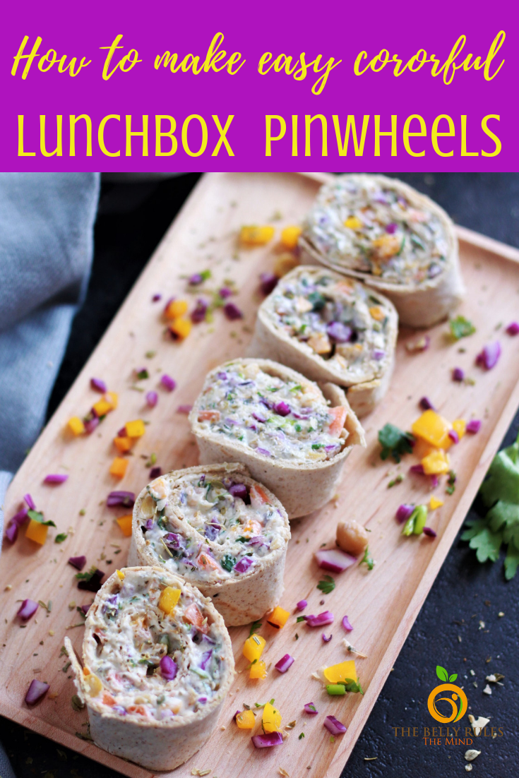This pinwheels recipe is the perfect finger food for your next gathering. Packed with rainbow colored veggies and chickpeas, not only are they nutritious but also super easy to make. Serve them up for the holidays, BBQ parties, game night, grilling party, birthday party or simply just pack them for lunch, they are always a hit. Try them yourself! #pinwheels #pinwheelsrecipe #pinwheelssandwich #hwotomakepinwheels #easypinwheelsrecipe #vegetarianpinwheels #rainbowpinwheels #tortillarollups #rainbowvegetables #chickpearecipe