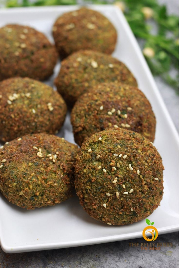 Crispy Falafel Recipe - Making Falafel from scratch is easier than you think and so much more healthier. Ultra crispy on the outside and perfectly moist and fluffy on the inside. Chickpeas, herbs and spices is all you need to bake them, air fry them or cook them in your aebleskiver pan. This recipe is easy to follow and has step by step photos and a video recipe. Vegan. Gluten-Free. Make-ahead & freezer friendly.