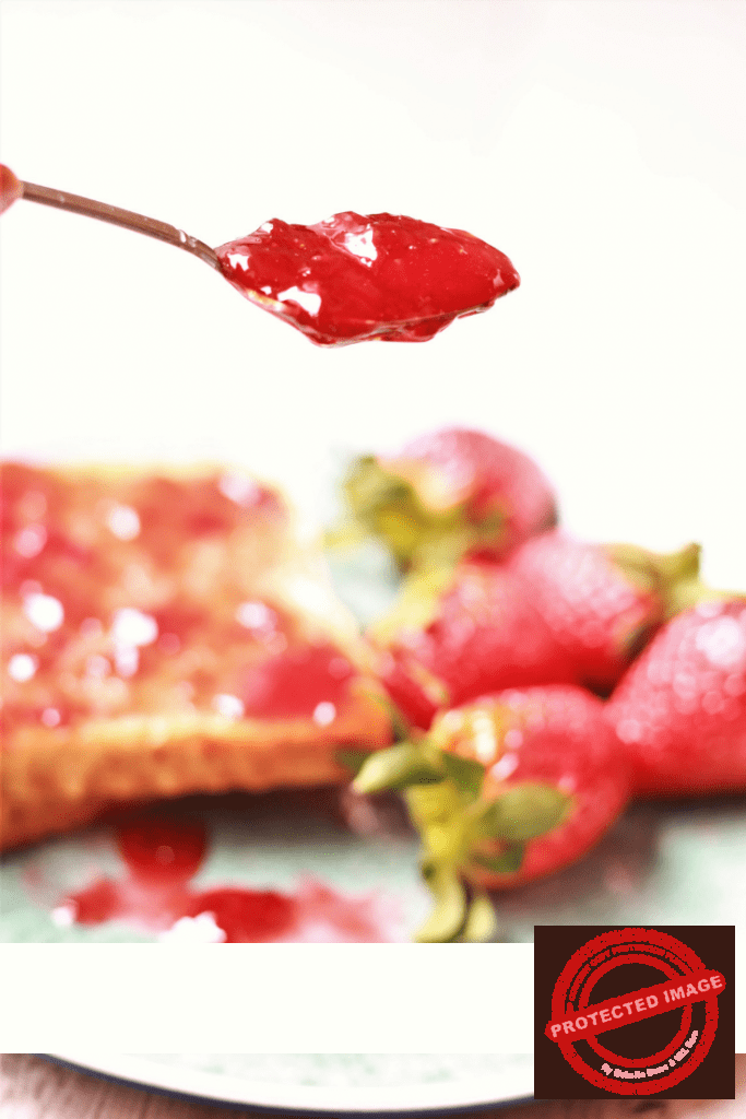thick strawberry jam on a spoon