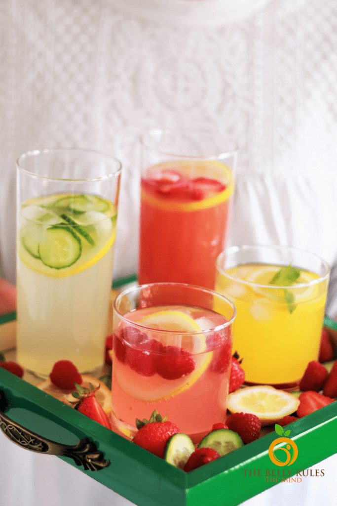 Homemade lemonade served 4 ways, pink lemonade, mango lemonade, strawberry lemonade and cucumber mint lemonade