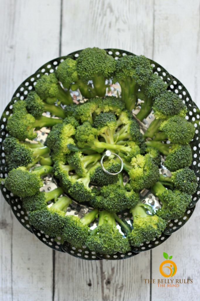 broccoli in a steamer basket