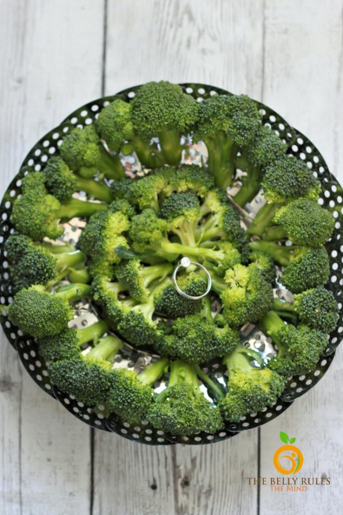 broccoli in a steamer basket