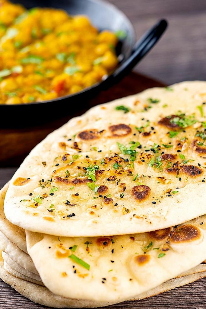 pile of garlic naan with curry
