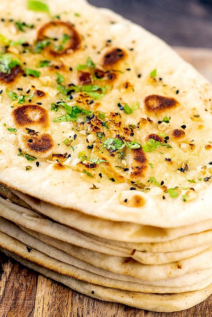 piled garlic naans