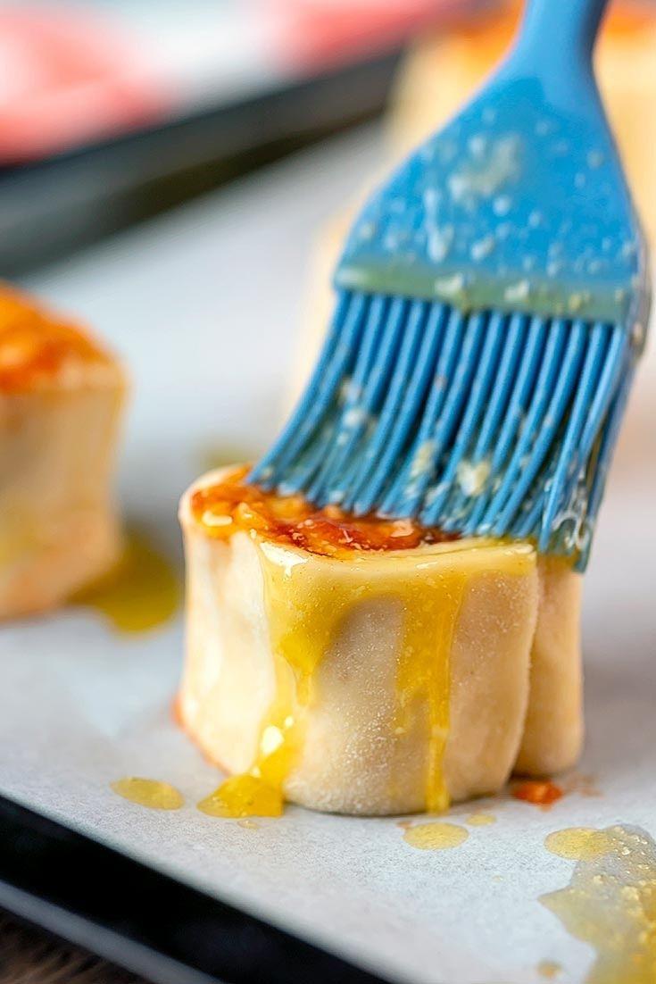 applying garlic butter