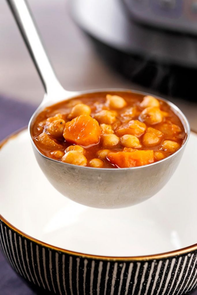 chickpea stew in a laddle